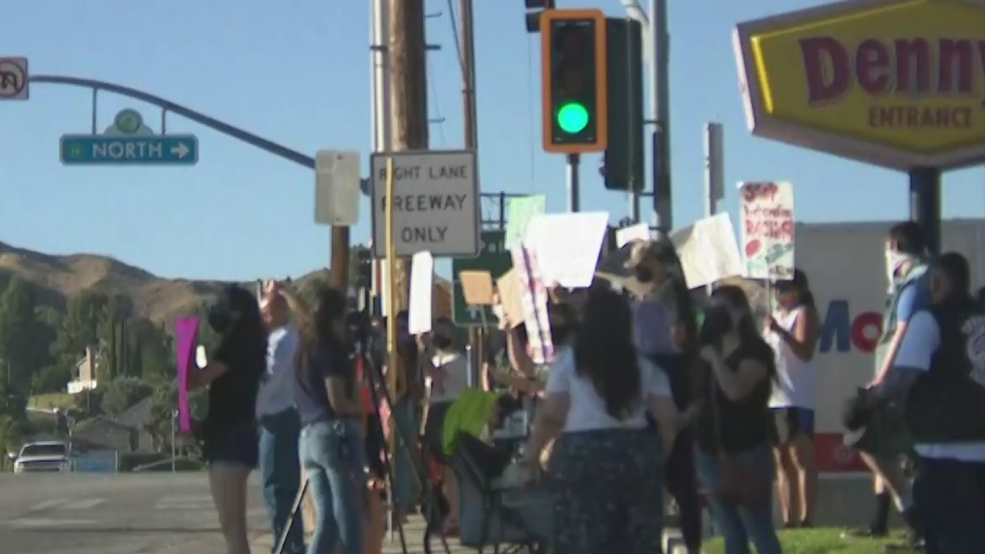 On July 18, 2020, protesters rally behind a pair of street vendors harassed by a local bar owner in a confrontation captured on camera days earlier in Canyon Country. (KTLA)