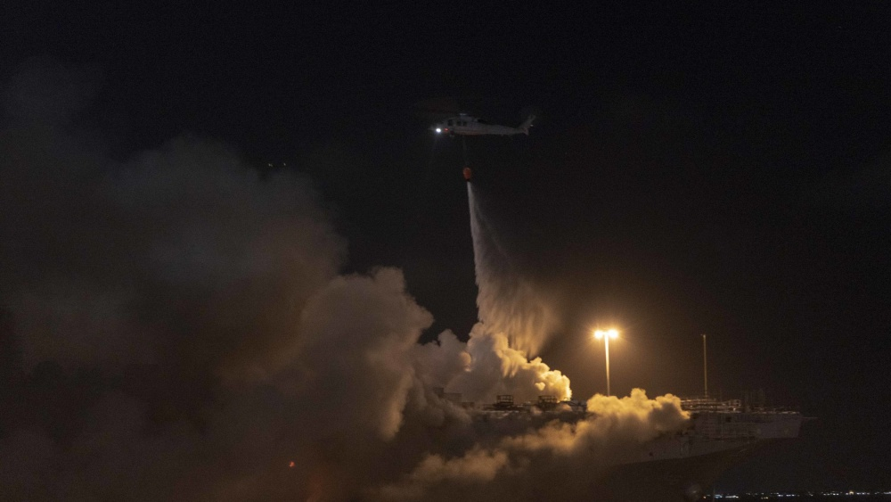 The Naval Surface Forces tweeted this image of an aerial unit dropping water at the burning USS Bonhomme Richard at Naval Base San Diego on July 13, 2020.