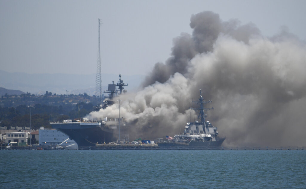Smoke rises from the USS Bonhomme Richard at Naval Base San Diego on July 12, 2020. (AP Photo/Denis Poroy)