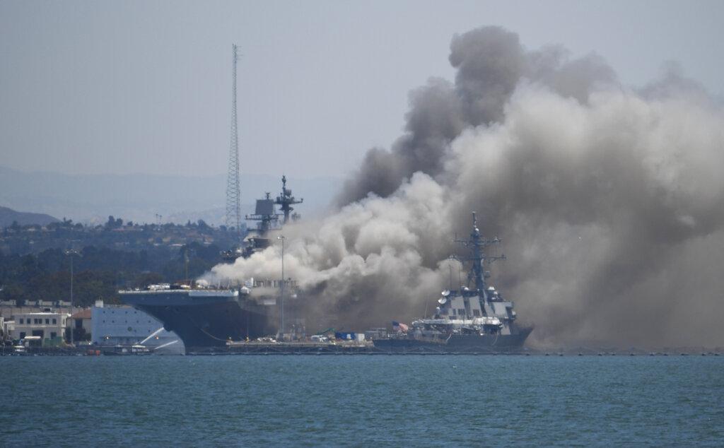 Smoke rises from the USS Bonhomme Richard at Naval Base San Diego on July 12, 2020. (AP Photo/Denis Poroy)