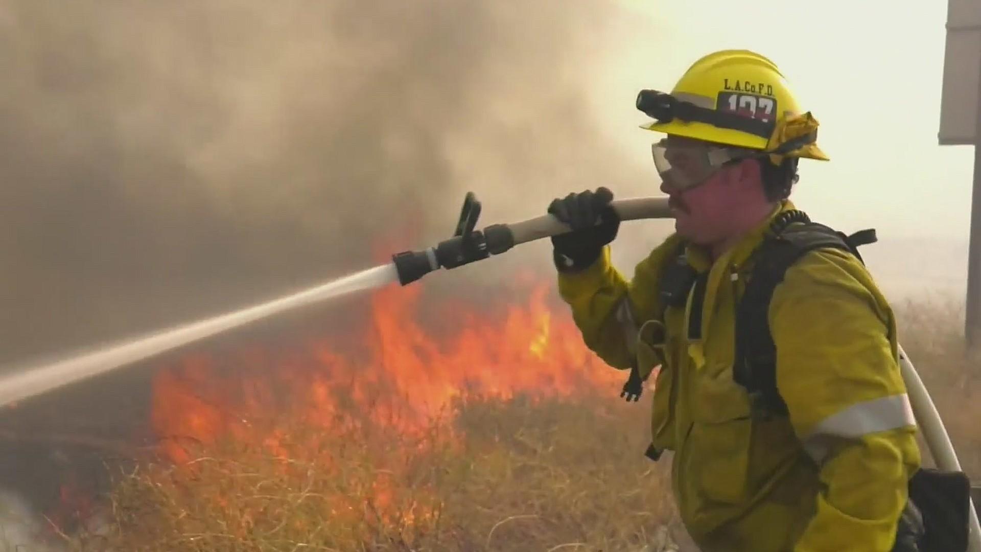 A firefighter battles the Soledad Fire in Santa Clarita on July 5, 2020. (KTLA)
