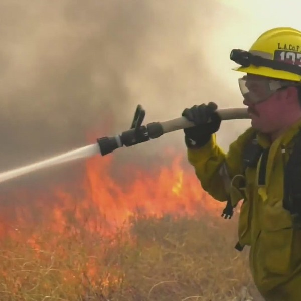 A firefighter battles the Soledad Fire in Santa Clarita on July 5, 2020. (KTLA)