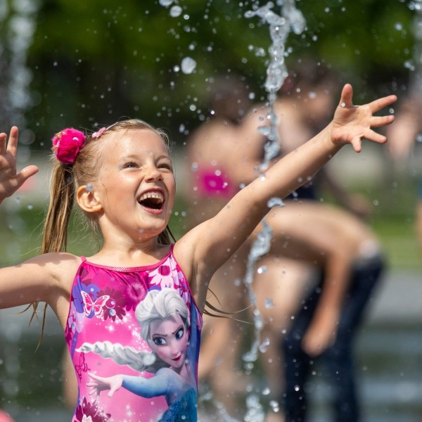 A child cools off in a public fountain in this file photo. (AP Photo/Mindaugas Kulbis)