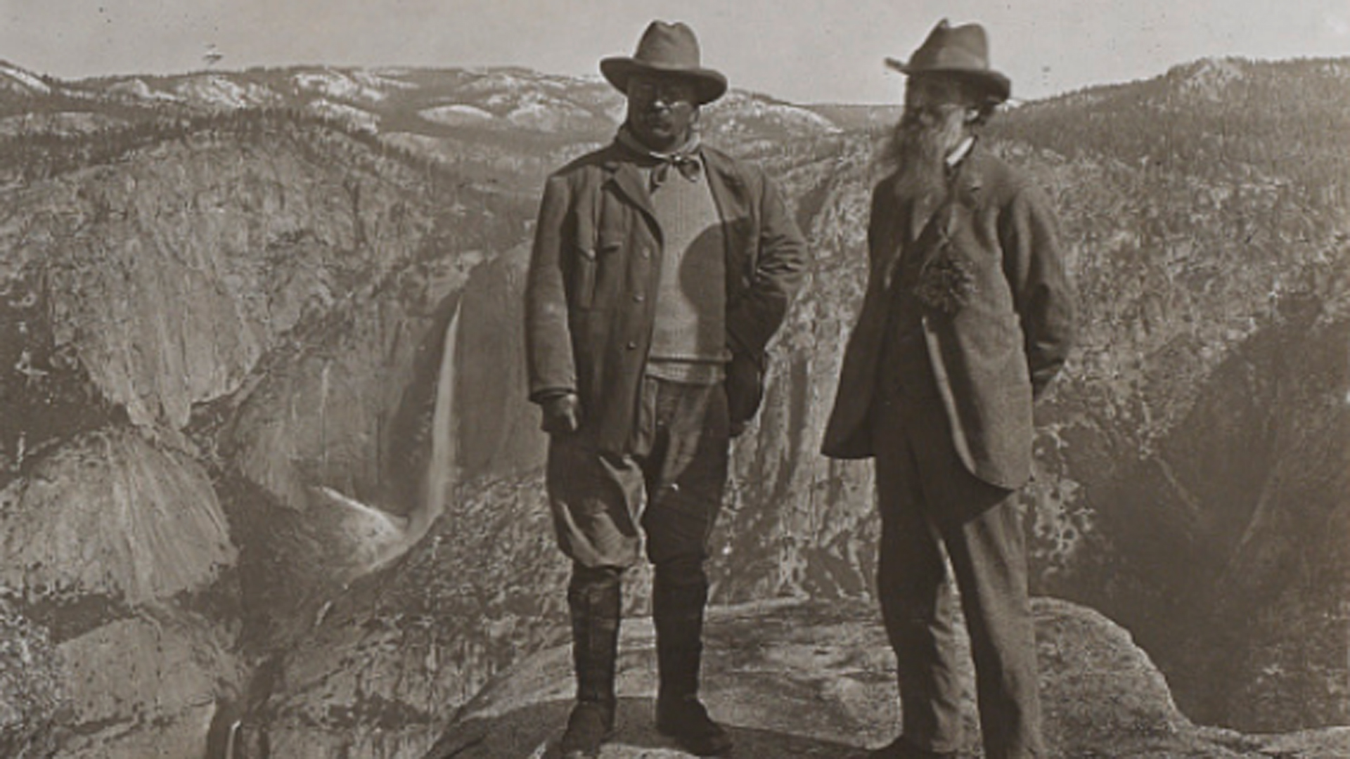 Theodore Roosevelt (left) and John Muir on Glacier Point above Yosemite Valley, California, in 1903. (via Library of Congress)