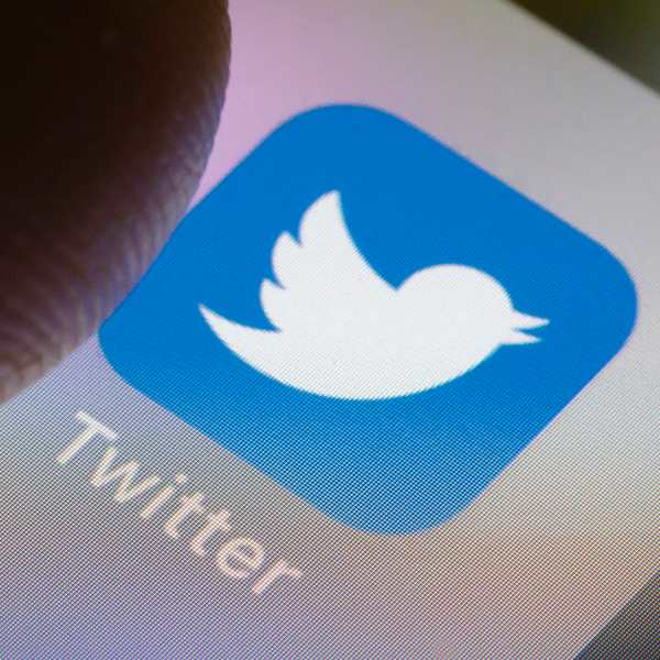 In this photo illustration the Twitter app is displayed on a smartphone. (Thomas Trutschel/Photothek via Getty Images)