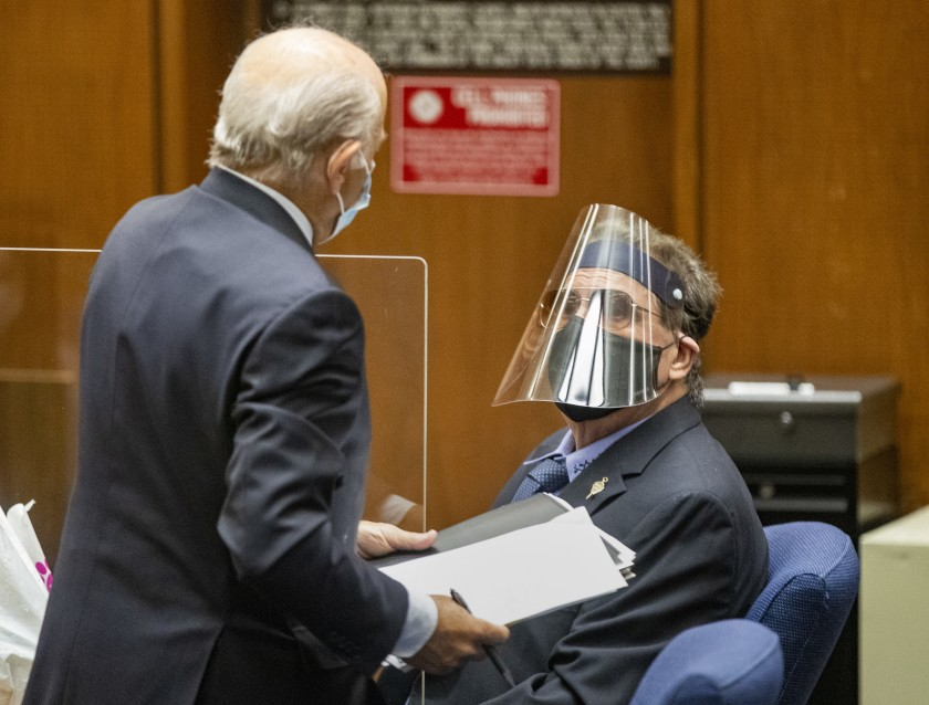 George Tyndall, right, USC's former longtime campus gynecologist, confers with attorney Leonard Levine on July 24, 2020. (Brian van der Brug / Los Angeles Times)