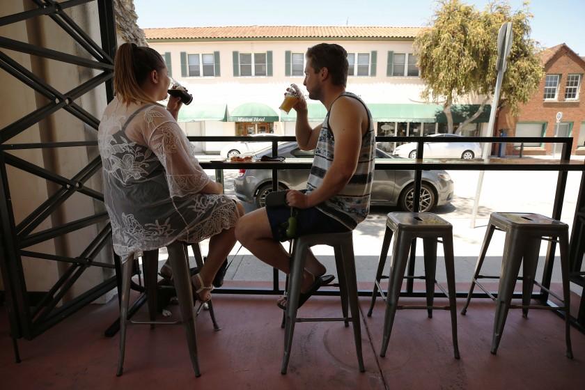 Matt and Leanne Harmon of Santa Clarita enjoy a beer at Ventura Coast Brewing Co. in this undated photo. (Al Seib / Los Angeles Times)