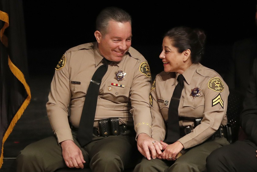 Sheriff Alex Villanueva, with his wife, Vivian, at the ceremony for his swearing in in 2018.(Mel Melcon / Los Angeles Times)