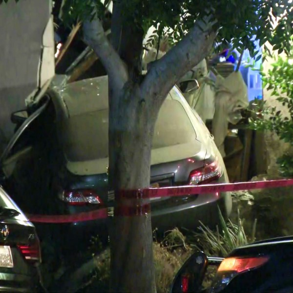 A car is seen after crashing into an apartment building in West Hollywood on July 29, 2020. (KTLA)