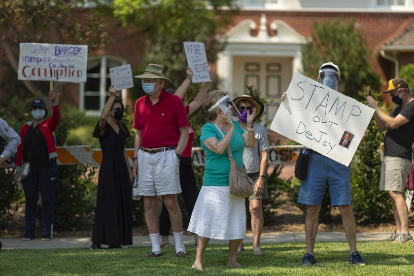 Protesters rally outside the home of USPS Board of Governors John M. Barger in San Marino on August 22, 2020, to decry recent U.S. Postal Service cuts by Postmaster General Louis DeJoy that could affect presidential election mail-in ballots. (David McNew/Getty Images)