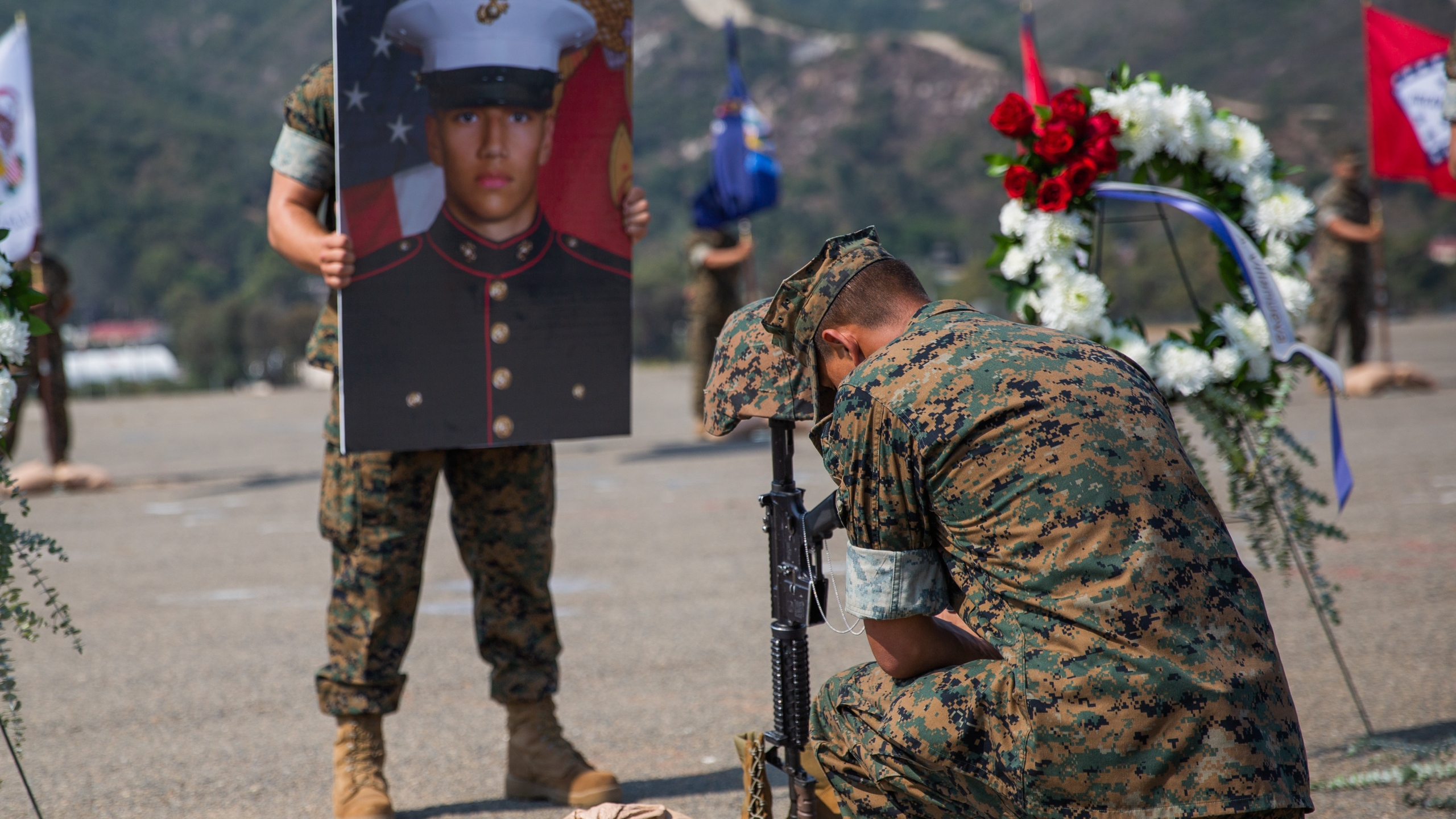 A U.S. Marine takes a knee to honor the fallen after a memorial service at Marine Corps Base Camp Pendleton, California, Aug. 21, 2020. The service was held in remembrance of the eight Marines and one Sailor from Bravo Company, Battalion Landing Team 1/4, 15th Marine Expeditionary Unit, who died in an assault amphibious vehicle mishap off the coast of San Clemente Island, California, July 30. (U.S. Marine Corps photo by Cpl. Jennessa Davey)