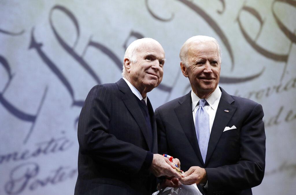 Sen. John McCain receives the Liberty Medal from former Vice President Joe Biden in Philadelphia on Oct. 16, 2017. (AP Photo/Matt Rourke)