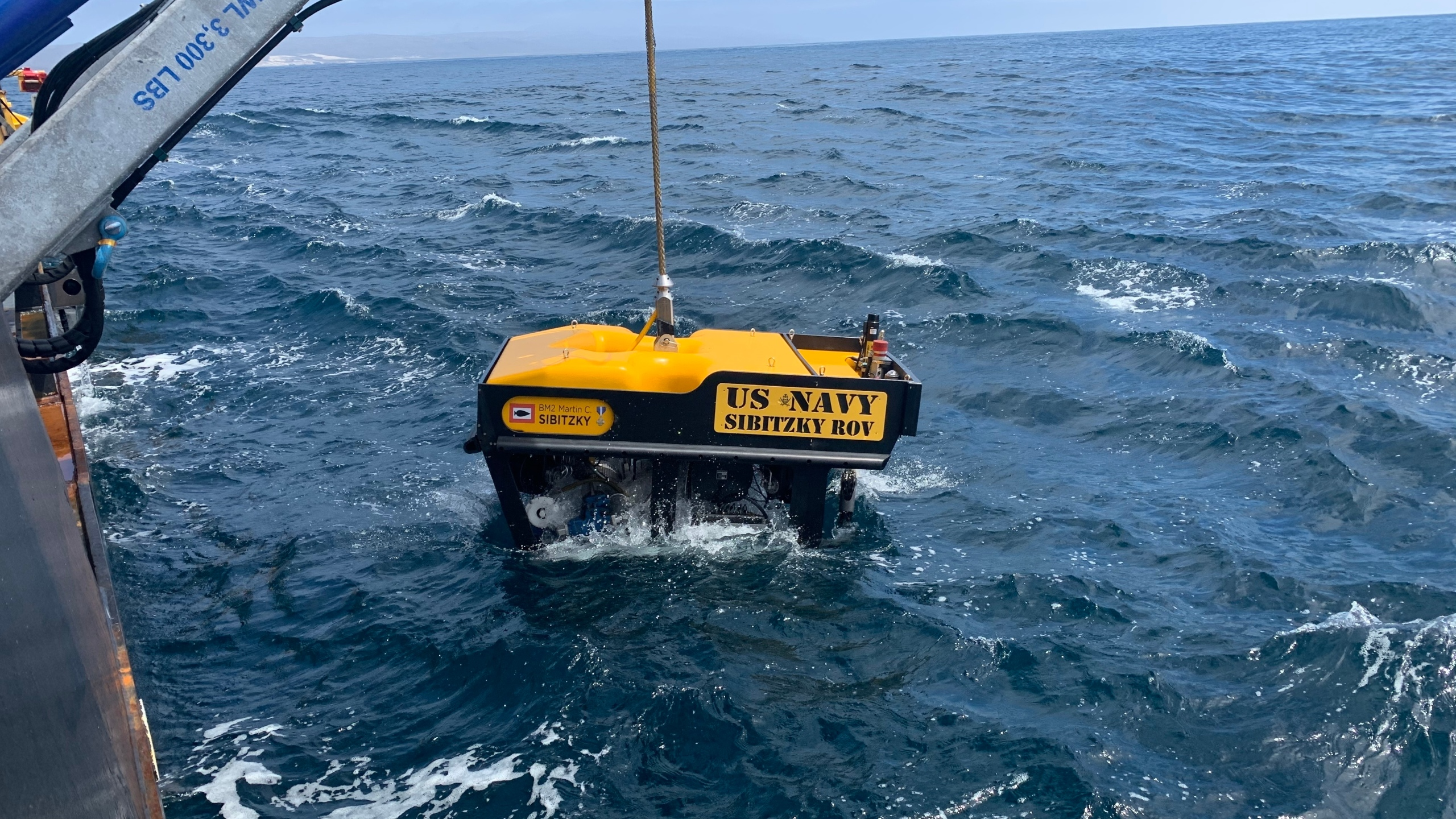 Crews deploy a remotely operated vehicle from the deck of a ship on Aug. 3, 2020, in the recovery of the seven Marines and one sailor missing off the coast San Clemente Island. (U.S. Navy / Lt. Curtis Khol)