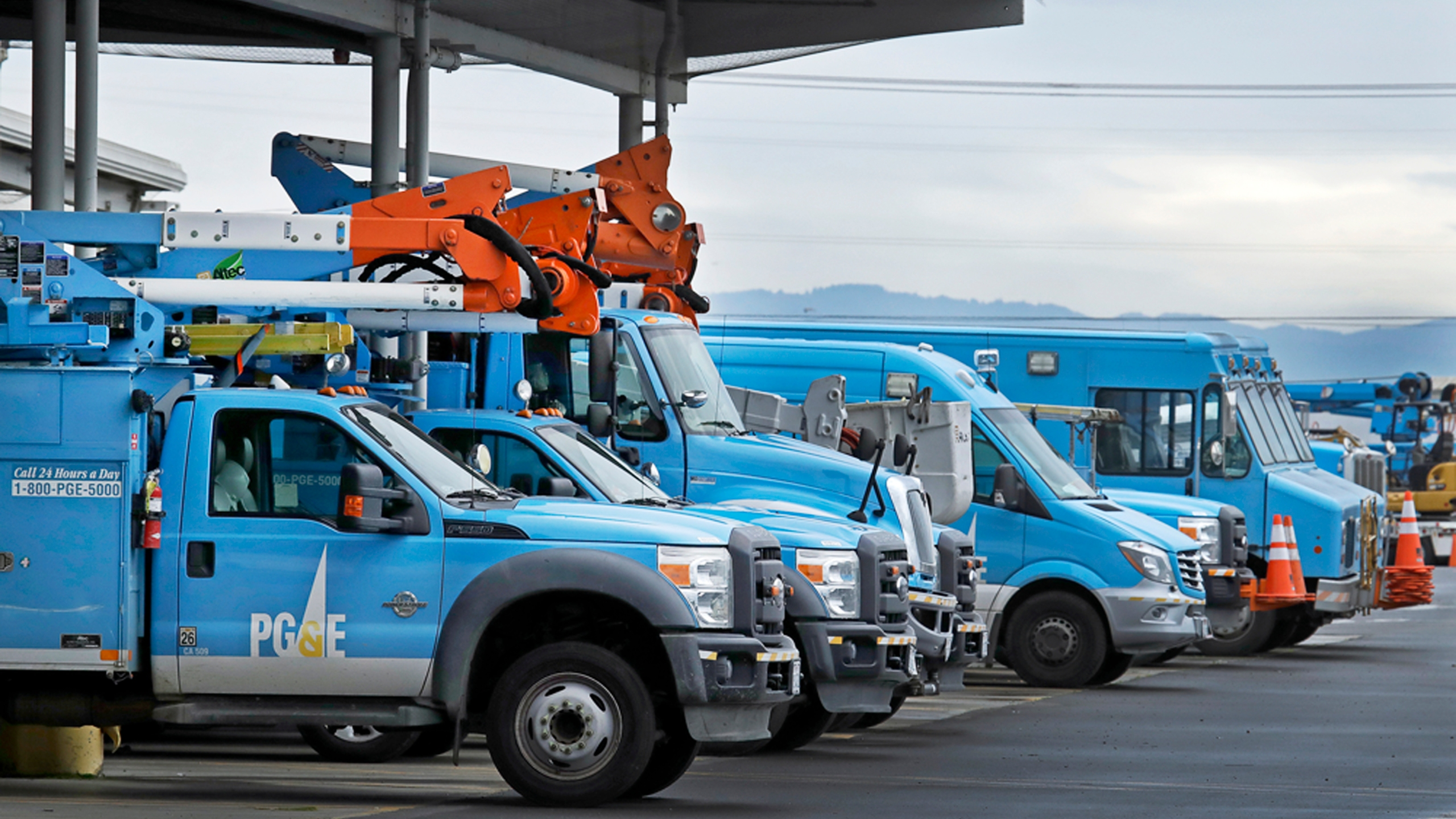 This Jan. 14, 2019, file photo shows Pacific Gas & Electric vehicles parked at the PG&E Oakland Service Center in Oakland, Calif. (AP Photo/Ben Margot, File)