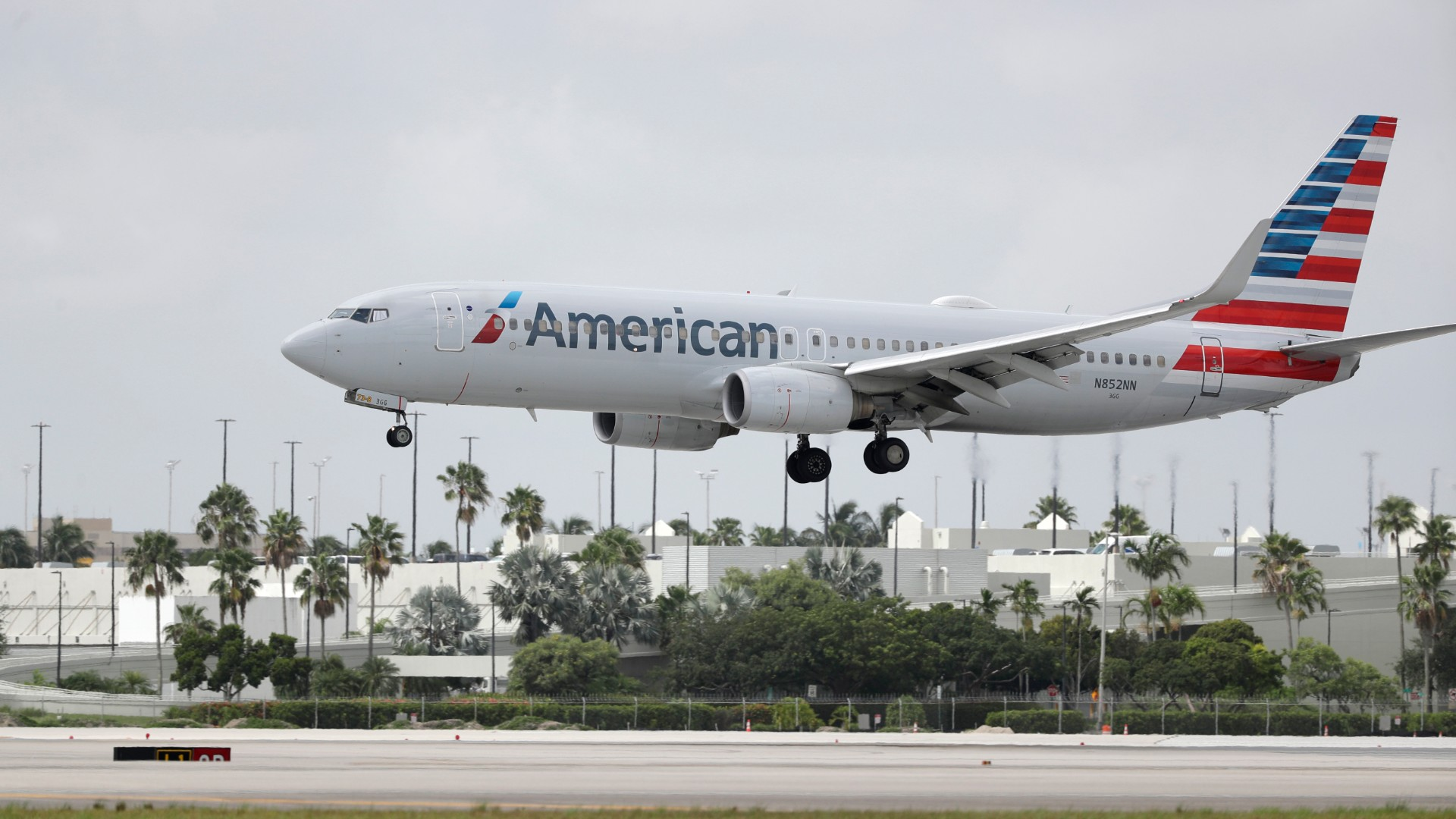 An American Airlines Boeing 737-823 lands at Miami International Airport, Monday, July 27, 2020, in Miami.American Airlines said Tuesday, Aug. 25 that it will furlough or lay off 19,000 employees in October as it struggles with a sharp downturn in travel because of the pandemic. Flight attendants will bear the heaviest cuts, with 8,100 losing their jobs. (AP Photo/Wilfredo Lee, File)