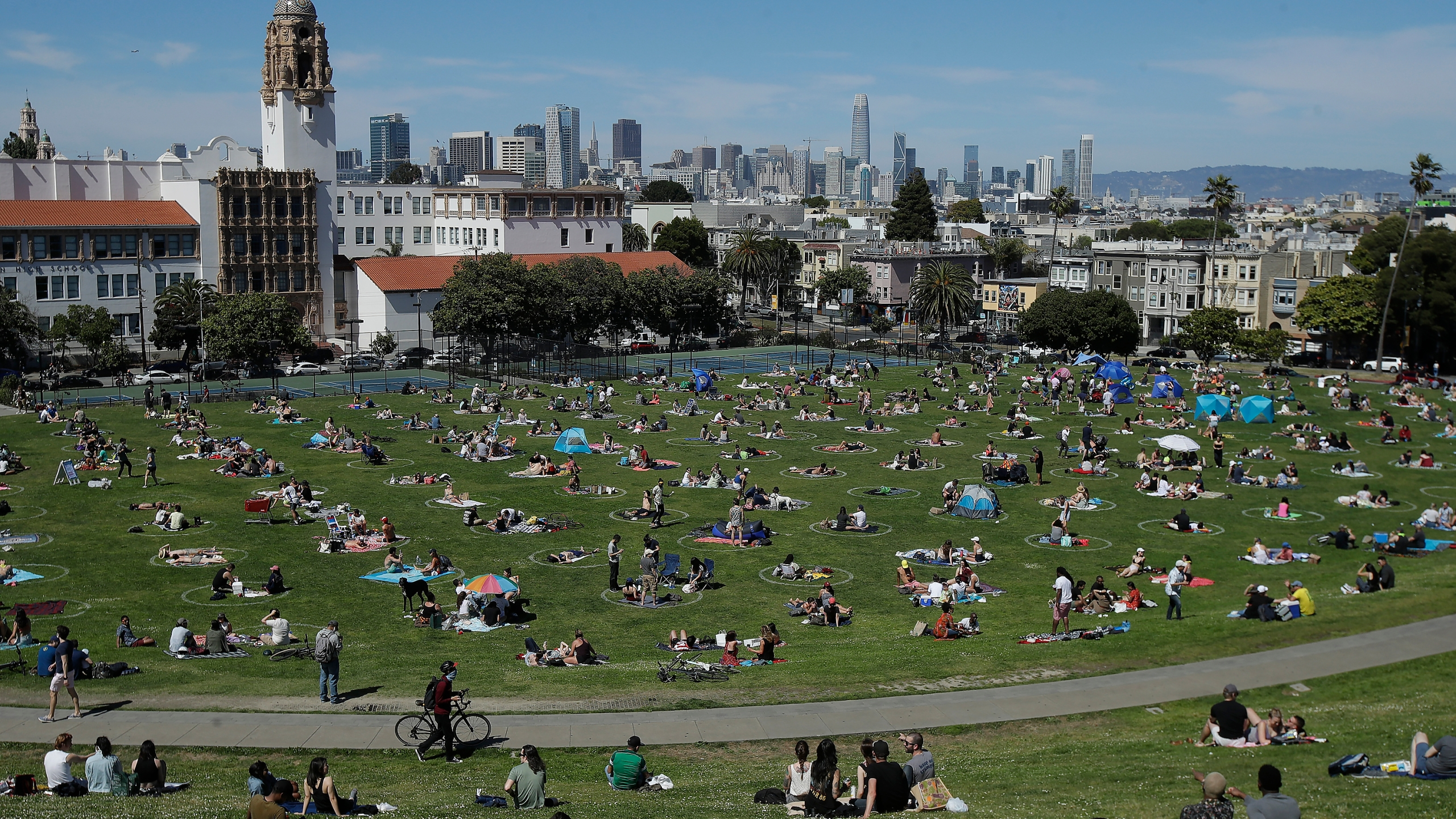 Visitors set up inside circles designed to help prevent the spread of the coronavirus by encouraging social distancing at Dolores Park in San Francisco on May 24, 2020. (AP Photo/Jeff Chiu, File)