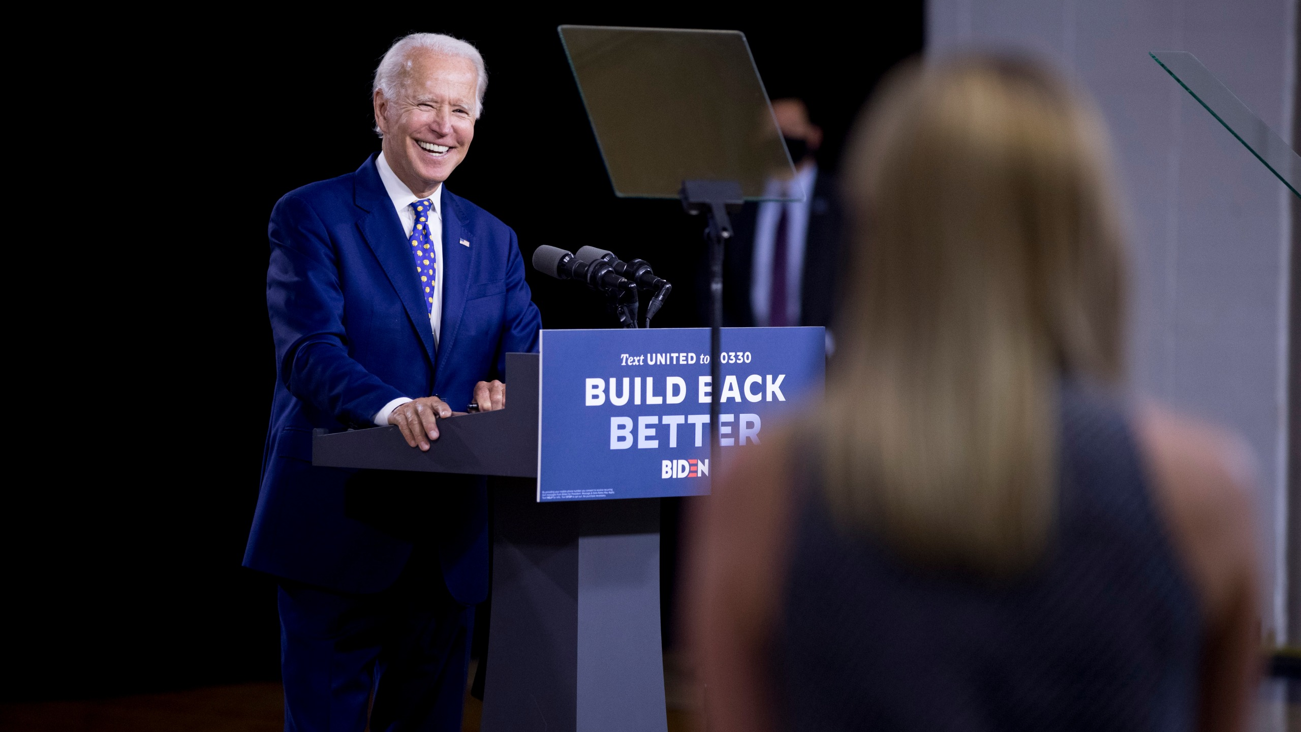 "Democratic presidential candidate former Vice President Joe Biden smiles as he takes a question from a reporter at a campaign event at the William ""Hicks"" Anderson Community Center in Wilmington, Del., Tuesday, July 28, 2020. (AP Photo/Andrew Harnik)"
