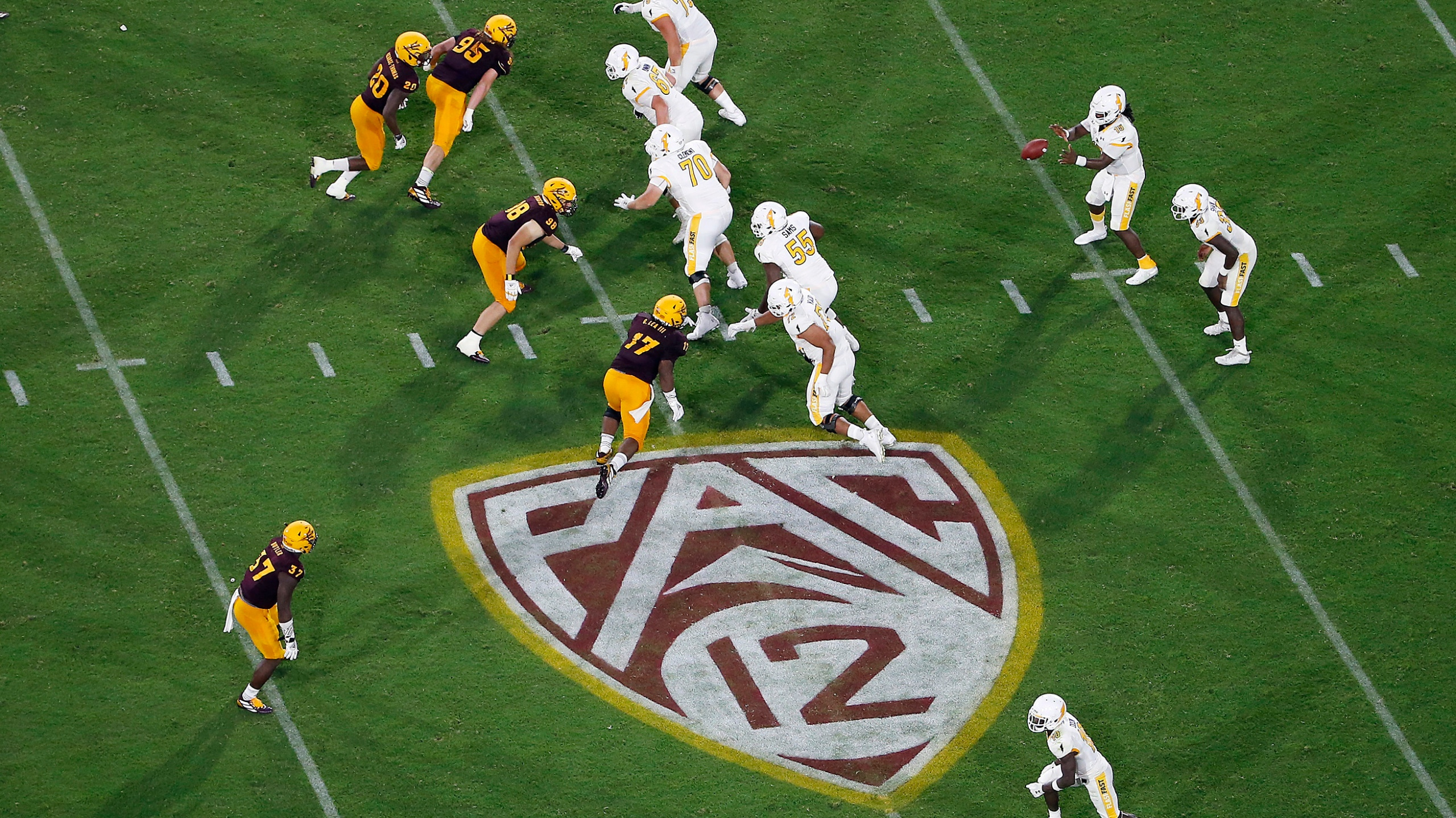 This Thursday, Aug. 29, 2019, file photo, shows the Pac-12 logo during the second half of an NCAA college football game between Arizona State and Kent State, in Tempe, Arizona. (AP Photo/Ralph Freso, File)