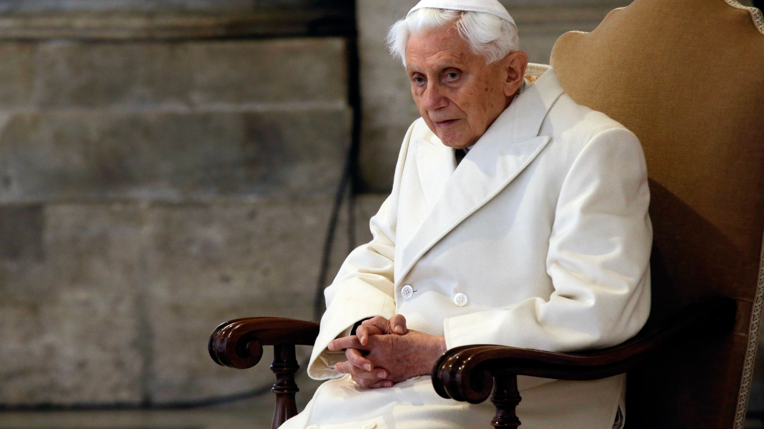 In this Tuesday, Dec. 8, 2015. filer, Pope Emeritus Benedict XVI attends a Mass prior to the opening of the Holy Door of St. Peter's Basilica, formally starting the Jubilee of Mercy, at the Vatican. (AP Photo/Gregorio Borgia, File)