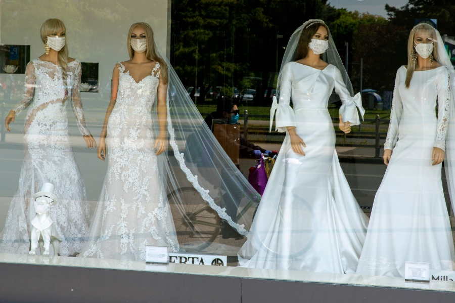 A wedding dress store with mannequins wearing face masks is seen in Zagreb, Croatia on April 23, 2020. (AP Photo/Darko Bandic, File)