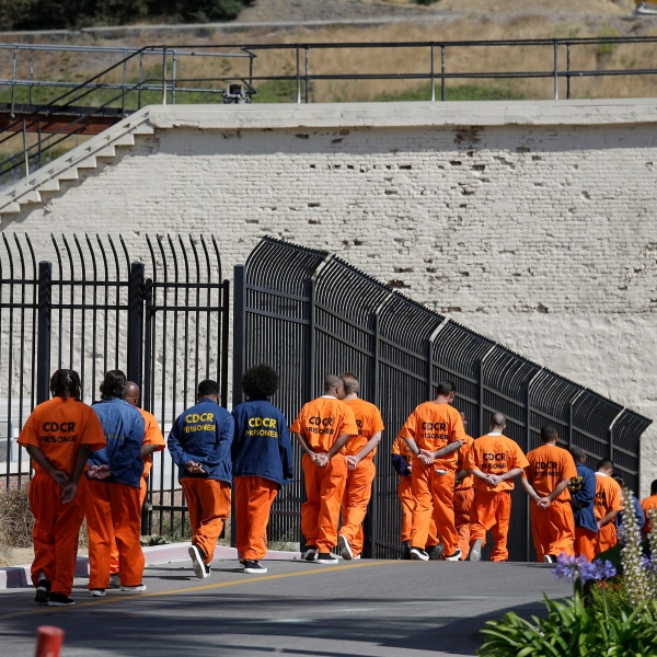 In this Aug. 16, 2016, file photo, a row of general population inmates walk in a line at San Quentin State Prison in San Quentin. (AP Photo/Eric Risberg, File)