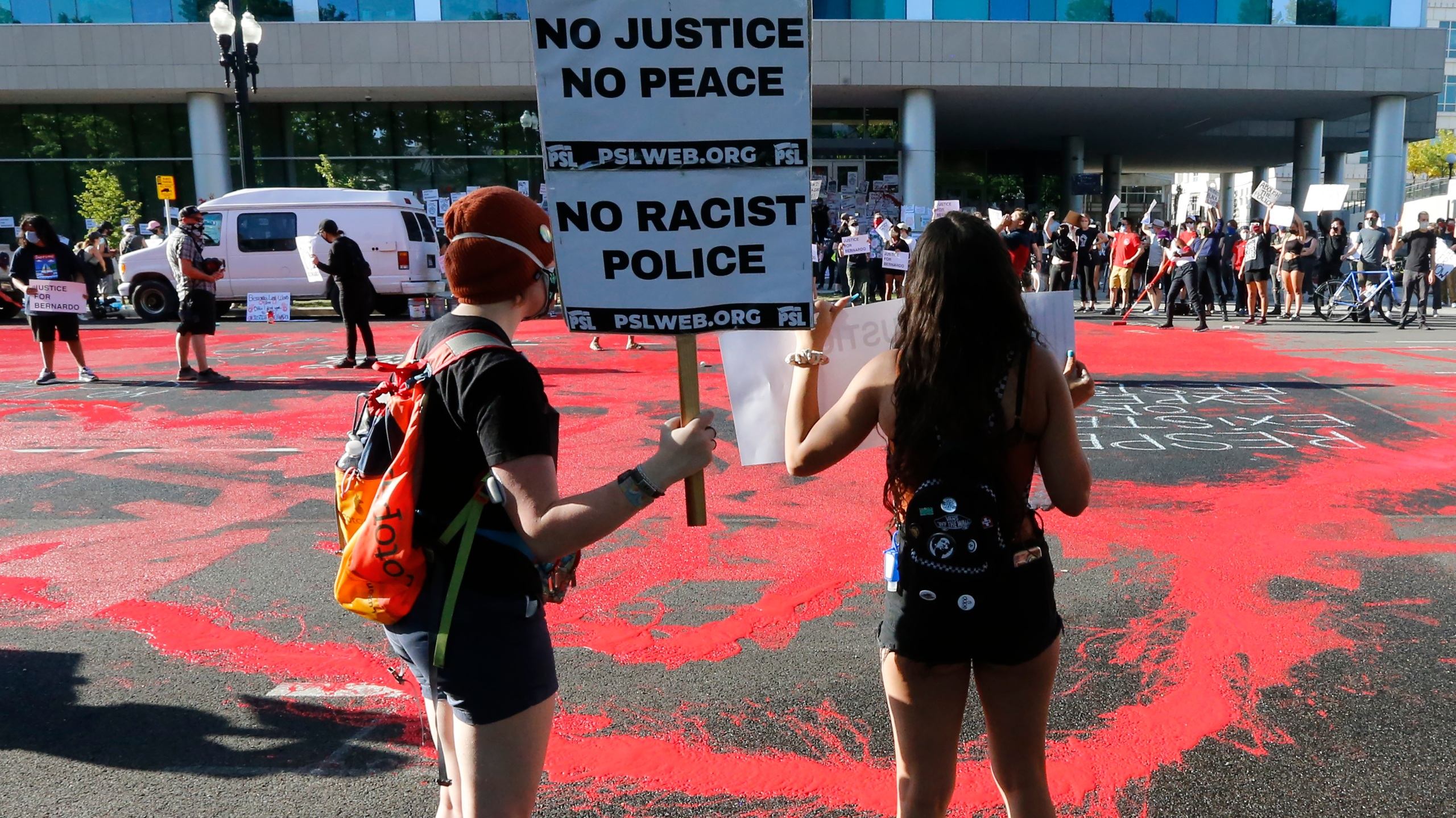 In this July 9, 2020, file photo, protesters gather in front of district attorney's office in Salt Lake City. (AP Photo/Rick Bowmer, File)