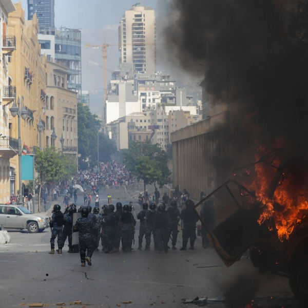 People clash with police during a protest against the government after the deadly explosion at Beirut port which devastated large parts of the capital and killed more than 150 people, in Beirut, Lebanon on Aug. 8, 2020. (AP Photo/Hassan Ammar)