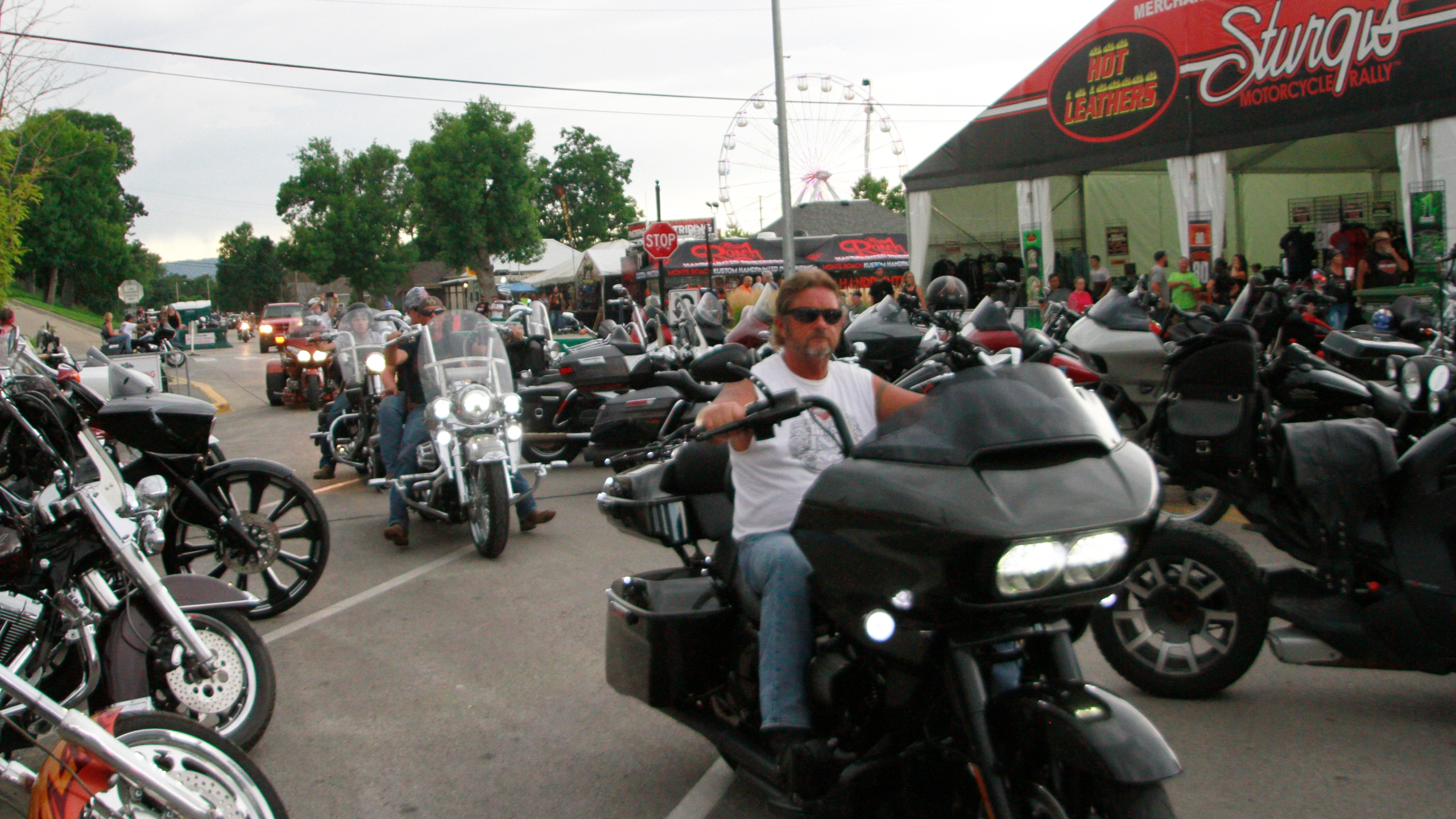 Bikers ride through downtown Sturgis on Friday, Aug. 7, 2020. (AP Photo/Stephen Groves)