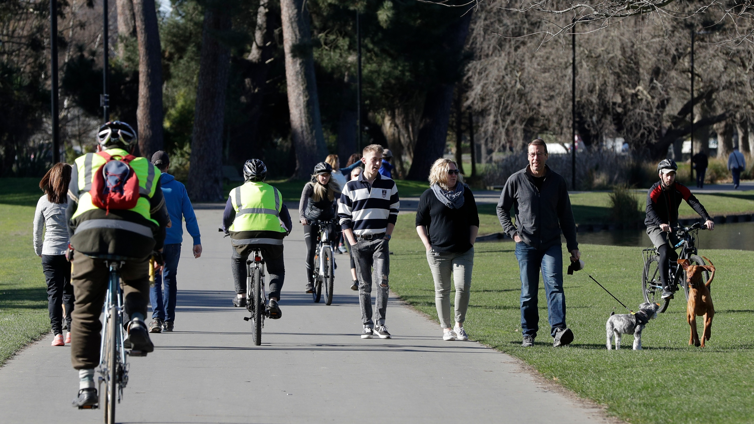 Residents exercise at Hagley Park in Christchurch, New Zealand, Sunday, Aug. 9, 2020. (AP Photo/Mark Baker)