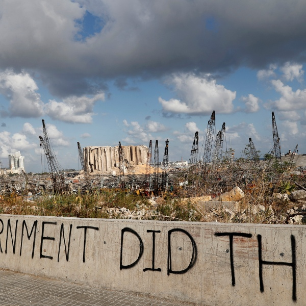 Words are written by Lebanese citizens in front of the scene of the explosion that hit the seaport of Beirut, Lebanon, Sunday, Aug. 9, 2020. (AP Photo/Hussein Malla)