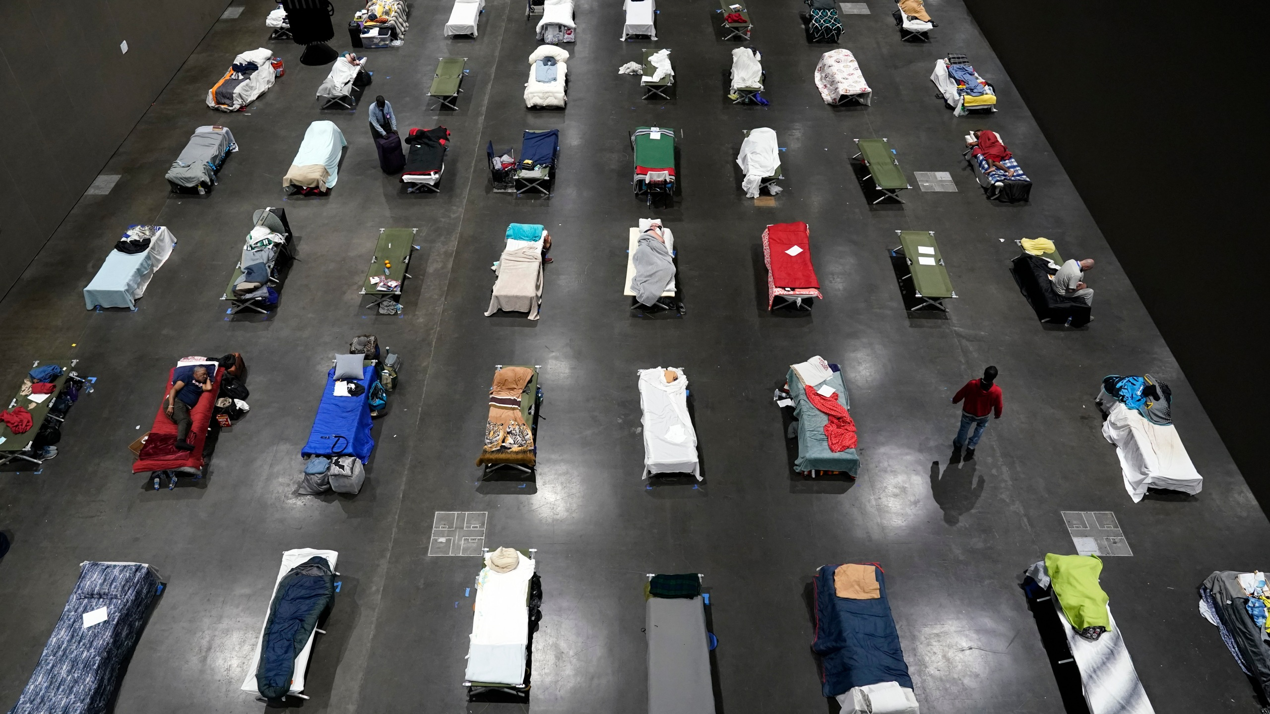 Beds fill a homeless shelter inside the San Diego Convention Center on Aug. 11, 2020, in San Diego. (AP Photo/Gregory Bull)