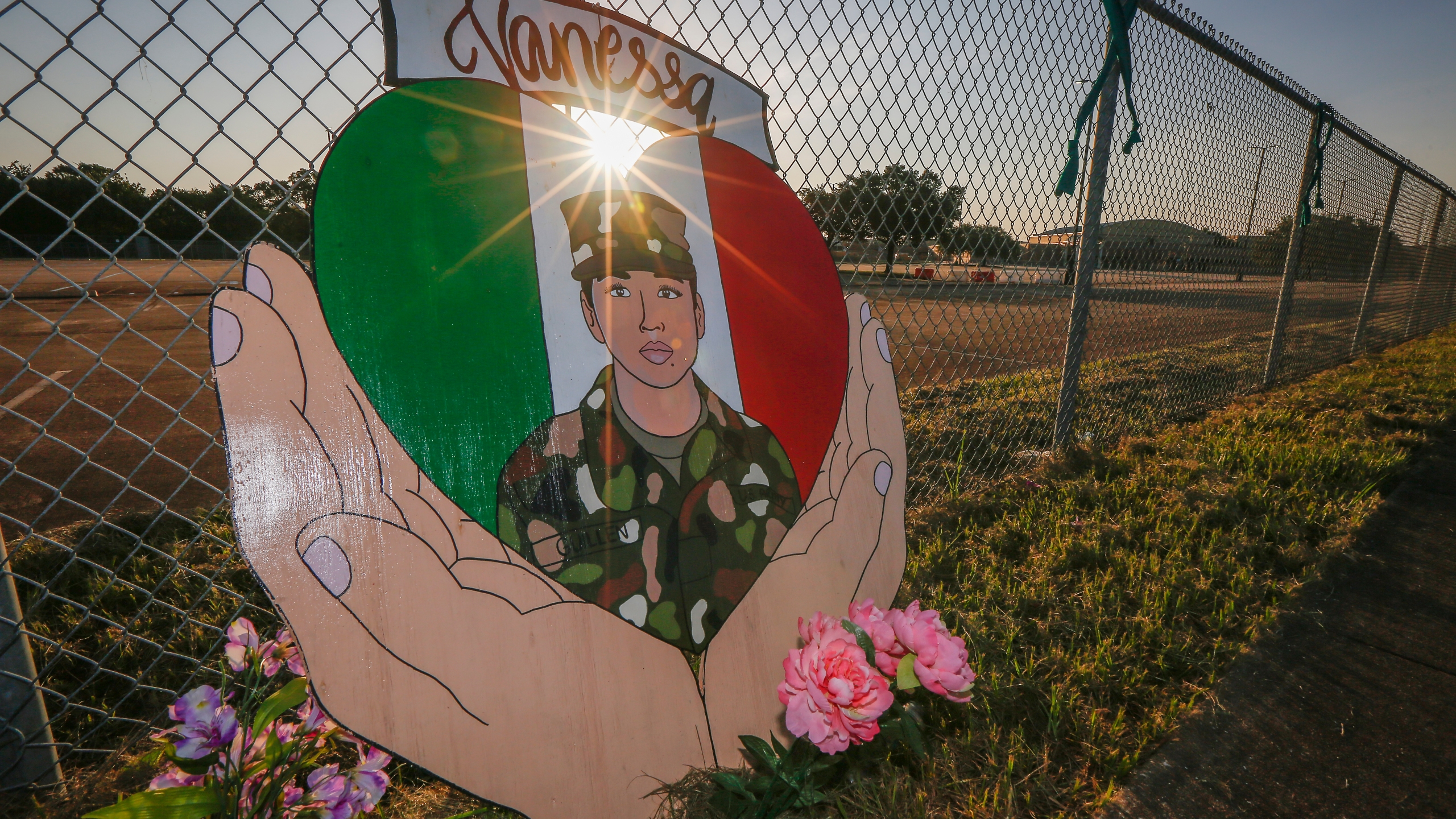 A small memorial for U.S. Army Specialist Vanessa Guillen is set up around Cesar Chavez High School Friday, Aug. 14, 2020, in Houston. Investigators said Guillen was bludgeoned to death on base by a fellow soldier, who later killed himself. (Steve Gonzales/Houston Chronicle via AP)