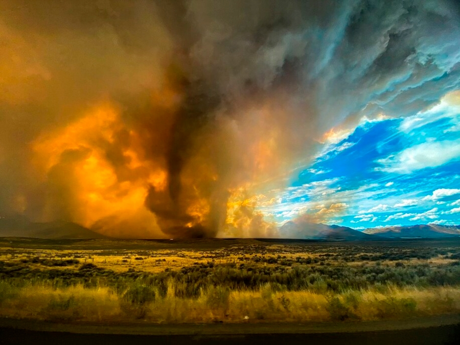 A funnel appears in a thick plume of smoke from the Loyalton Fire is seen in Lassen County, California, on Aug. 15, 2020. (Katelynn and Jordan Hewlett via AP)