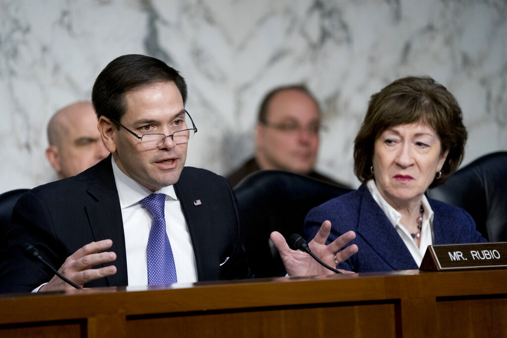 In this March 21, 2018 file photo, Sen. Marco Rubio, R-Fla., left, accompanied by Sen. Susan Collins, R-Maine,right, speaks before a Senate Intelligence Committee hearing on election security on Capitol Hill in Washington. The Senate intelligence committee has concluded that the Kremlin launched an aggressive effort to interfere in the 2016 presidential contest on behalf of Donald Trump. The Republican-led panel on Tuesday released its fifth and final report in its investigation into election interference. (AP Photo/Andrew Harnik)