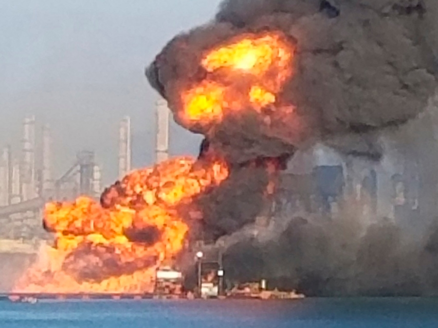 Coast Guard crews respond to a dredge on fire in the Port of Corpus Christi Ship Channel on Aug. 21, 2020, in Corpus Christi, Texas. (U.S. Coast Guard via AP)