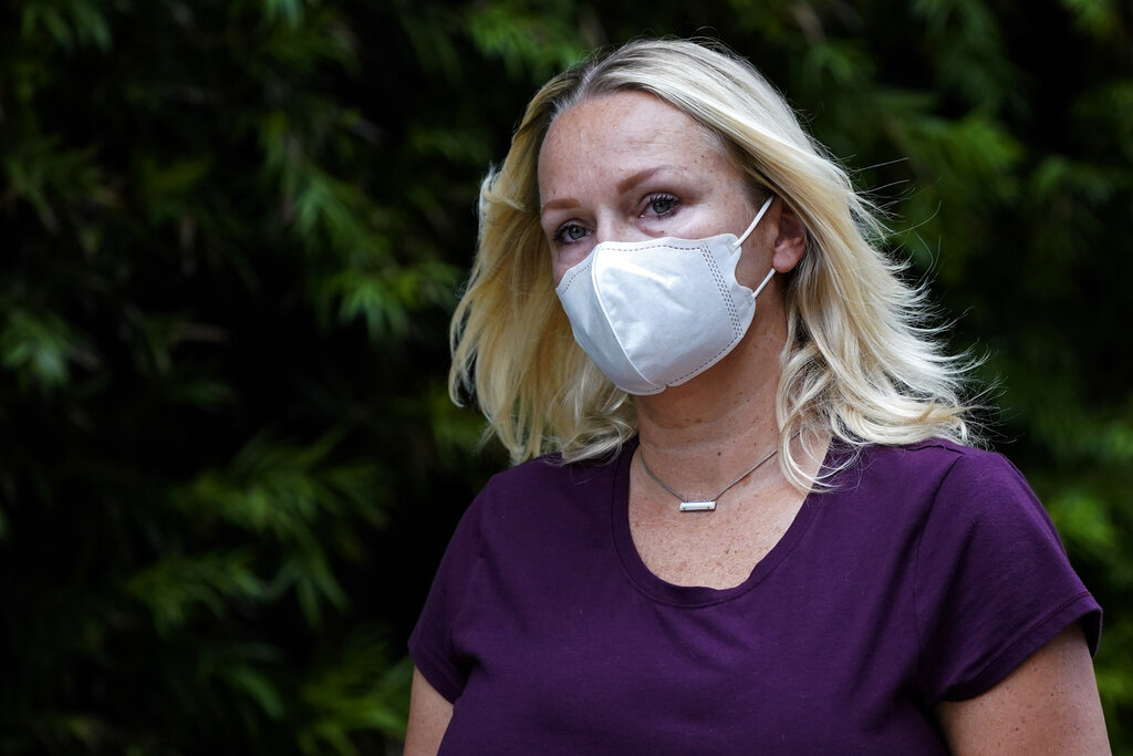 Margaret Hunter, the wife of former California Republican Rep. Duncan Hunter, leaves a federal building on Aug. 24, 2020, in San Diego. (AP Photo/Gregory Bull)