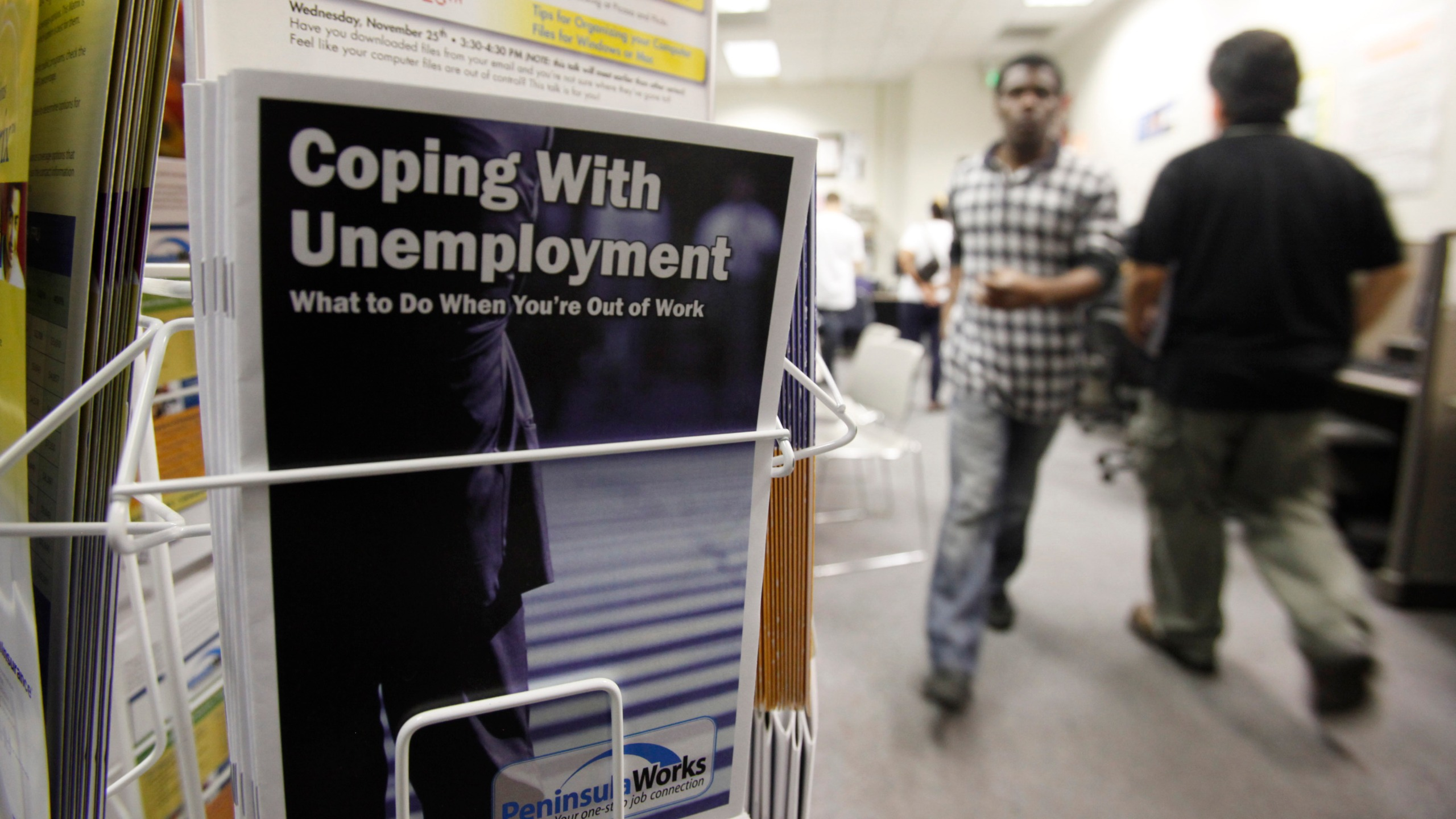 In this July 20, 2010 file photo, people arrive to seek employment opportunities at a JobTrain office in Menlo Park. (AP Photo/Paul Sakuma, File)