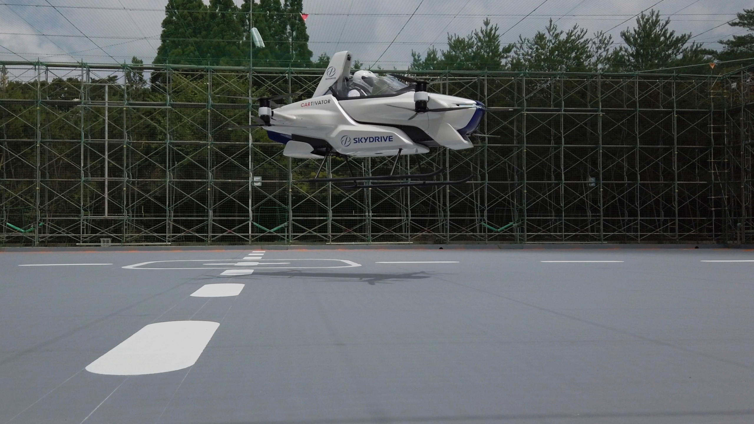 "This photo taken in August, 2020 shows a test flight of a manned '""flying car"" at Toyota Test Field in Toyota, central Japan. (©SkyDrive/CARTIVATOR 2020 via AP)"