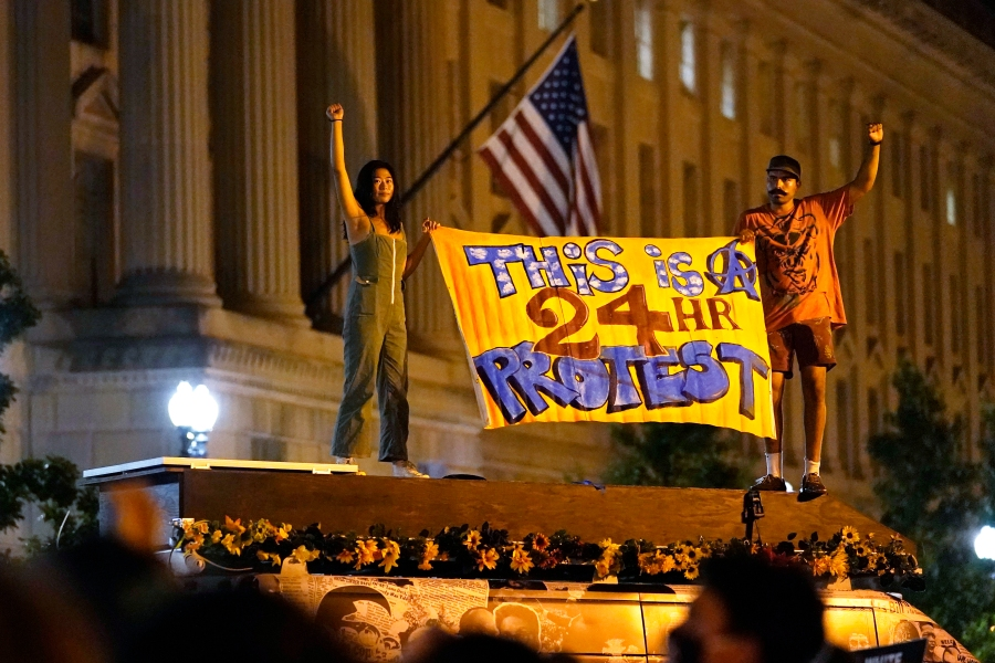 Protestors rally on Aug. 27, 2020, in Washington, D.C. President Donald Trump is set to deliver his acceptance speech later Thursday night from the nearby White House South Lawn. (AP Photo/Carolyn Kaster)