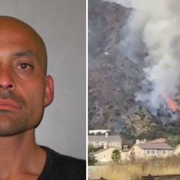 Osmin Palencia, 36, is seen in a photo shared by Azusa police. On the right, the Ranch 2 Fire is seen burning near homes. ( Angeles National Forest)