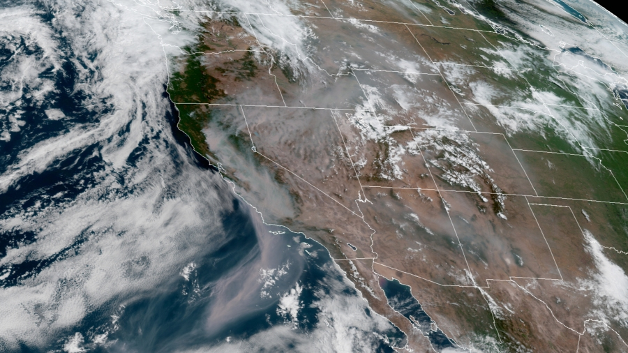 Smoke from the wildfires in California is seen stretching some 600 miles off the coast of California and over several states in a NOAA satellite image dated August 20. (GOES-17/NOAA)