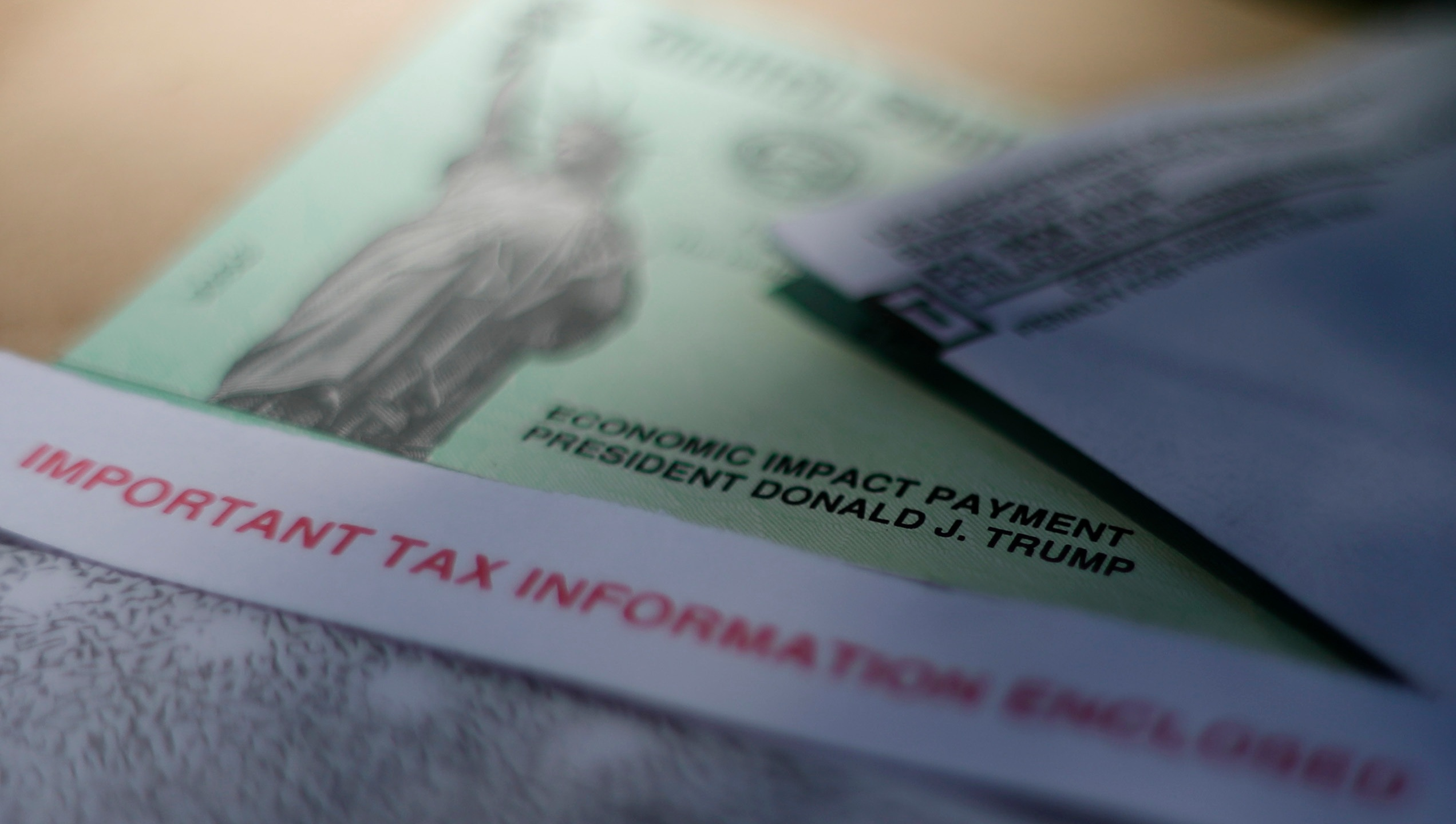 This April 23, 2020, file photo shows President Donald J. Trump's name printed on a stimulus check issued by the IRS to help combat the adverse economic effects of the new coronavirus outbreak in San Antonio. (AP Photo/Eric Gay, File)