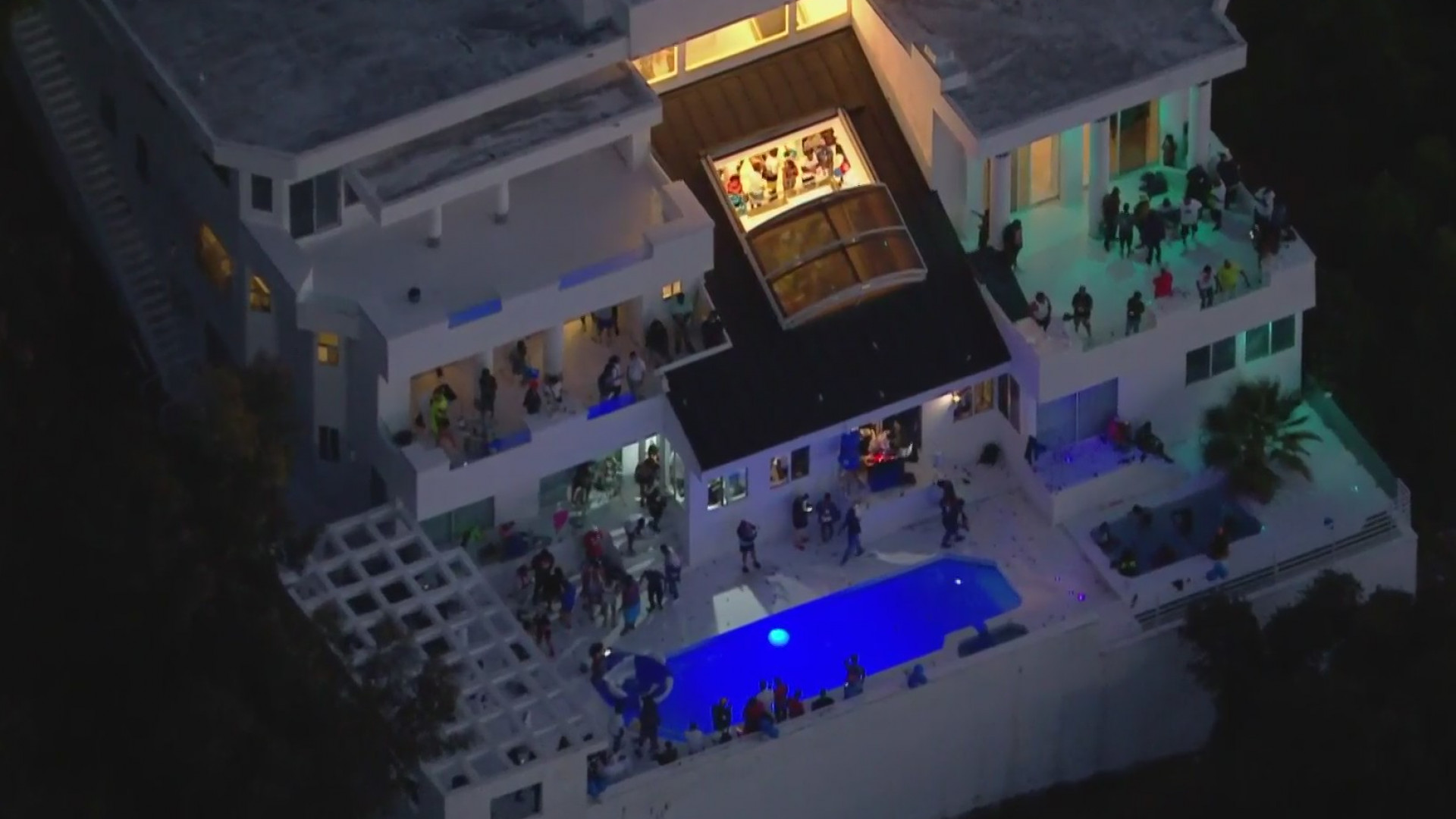 People party at a mansion in Beverly Crest before police responded to a shooting there on Aug. 4, 2020. (KTLA)