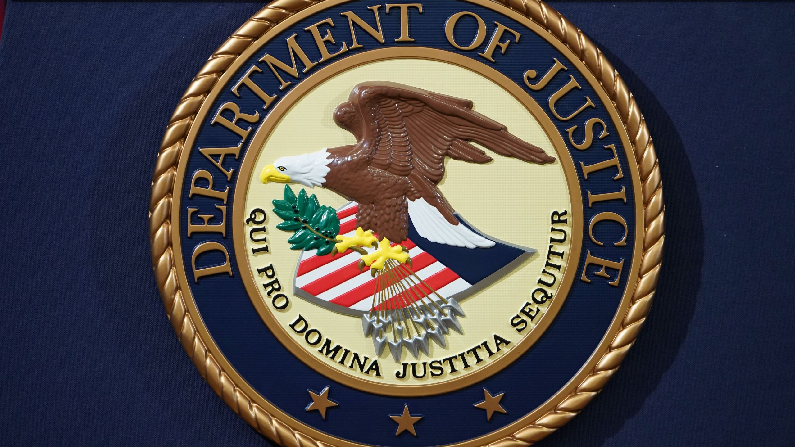 The Department of Justice seal is seen on a lectern ahead of a press conference announcing efforts against computer hacking and extortion at the Department of Justice in Washington, DC on November 28, 2018. (MANDEL NGAN/AFP via Getty Images)