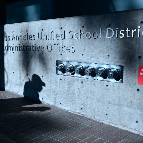 The shadow of a passing pedestrian is seen at the Los Angeles Unified School District headquarters in Los Angeles, California on Jan. 9, 2019. (FREDERIC J. BROWN/AFP via Getty Images)