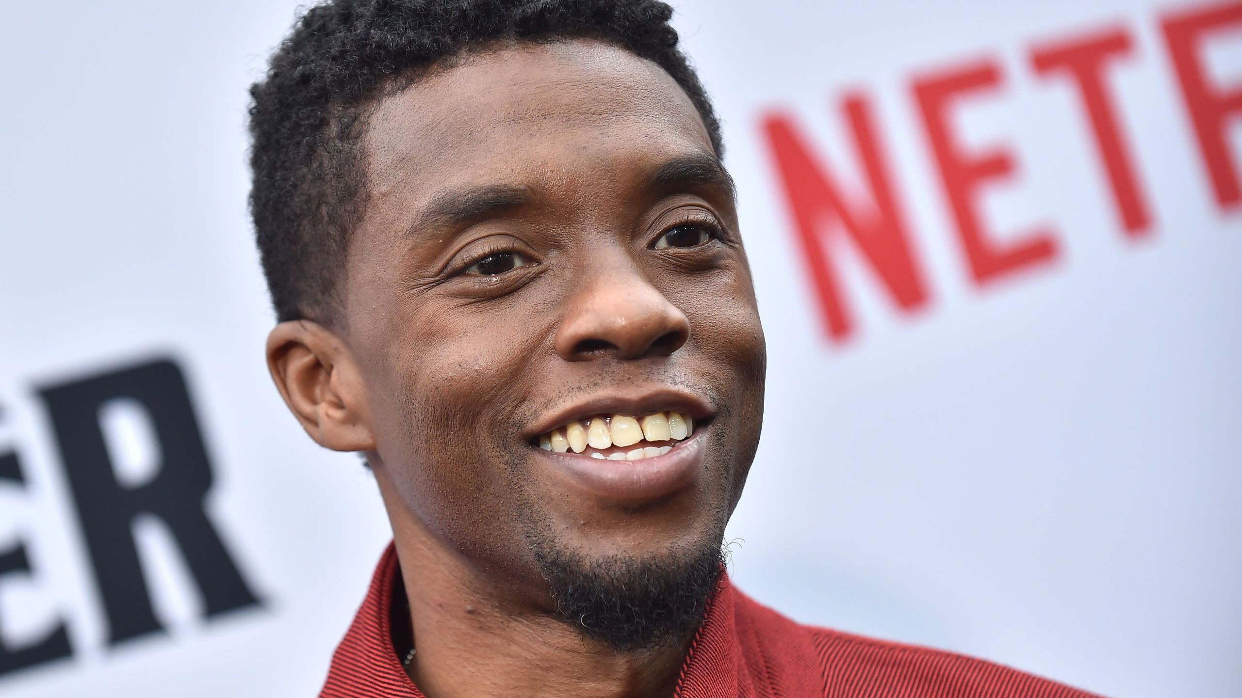 """U.S. actor Chadwick Boseman attends Netflix's """"The Black Godfather"""" premiere at Paramount Studios Theatre on June 3, 2019 in Los Angeles. (LISA O'CONNOR / AFP via Getty Images)"""