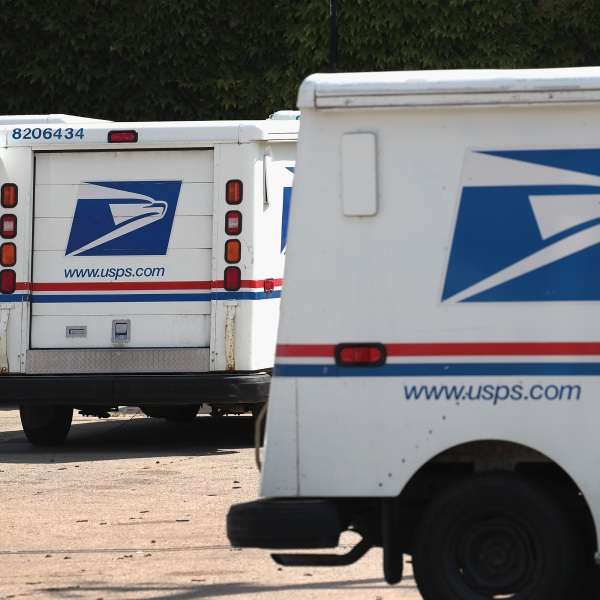 United States Postal Service (USPS) trucks are parked at a postal facility on August 15, 2019 in Chicago, Illinois. (Scott Olson/Getty Images)