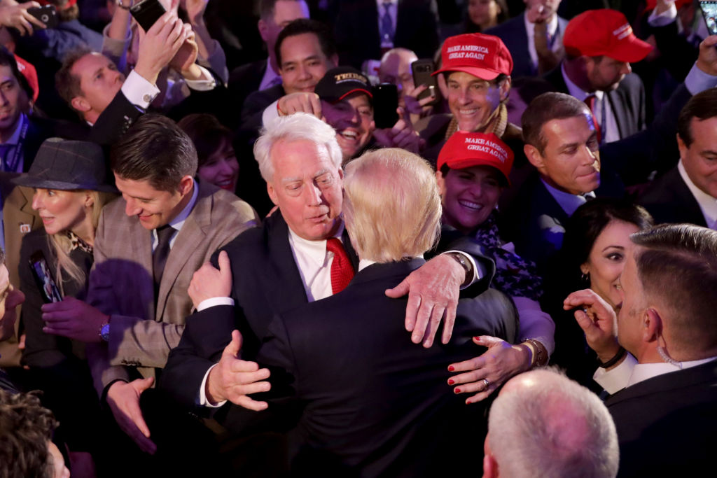 Donald Trump hugs his brother Robert Trump after delivering his acceptance speech at the New York Hilton Midtown in the early morning hours of Nov. 9, 2016, in New York City. (Chip Somodevilla/Getty Images)