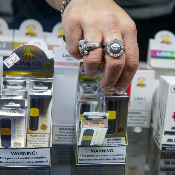 A worker organizes E-cigarette disposable units in a Jersey City, New Jersey, store on Jan. 2, 2020. (Eduardo Munoz Alvarez / Getty Images)