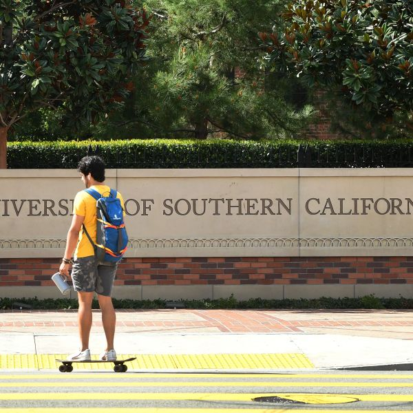 A skateboarder commutes at the University of Southern California on March 11, 2020. (FREDERIC J. BROWN/AFP via Getty Images)